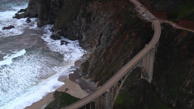 bixby creek bridge with beach below - aerial - bixby creek bridge stock videos & royalty-free footage