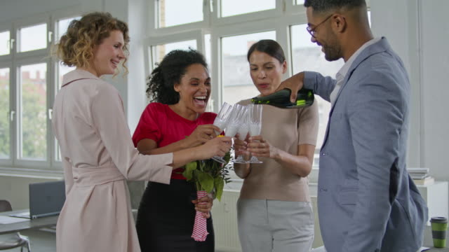 biz partners congratulating each other and celebrating successful deal with opening a bottle of sparkling wine and clinking glasses. - celebratory toast stock videos & royalty-free footage