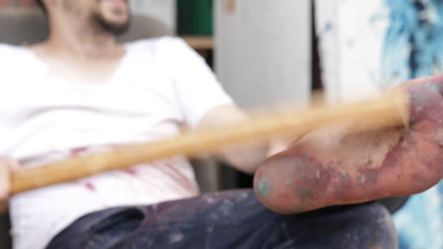 bizarre artist cleaning feet - stick plant part stock videos & royalty-free footage