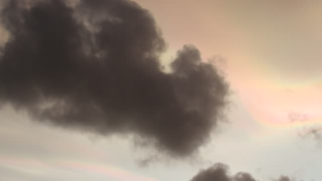 bizarre lighting effects in nacreous clouds at sunset over ambleside, caused by refraction off ice crystals in high clouds affected by the extreme wind speeds. - ice crystal stock videos & royalty-free footage