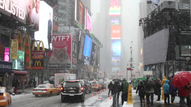 a bizzard scene with traffic in times square new york. - north america stock videos & royalty-free footage