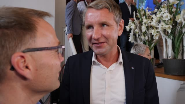 bjoern hoecke head of the alternative fuer deutschland political party in thuringia leaves the stage and speaks to the media to initial exit poll... - deutschland stock videos & royalty-free footage