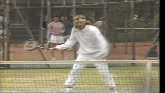 bjorn borg selling tennis memorabilia; file / tx 4.7.81 england: south london: wimbledon: borg warming up on court file / tx 29.2.84 london: harrods:... - international tennis federation stock videos & royalty-free footage