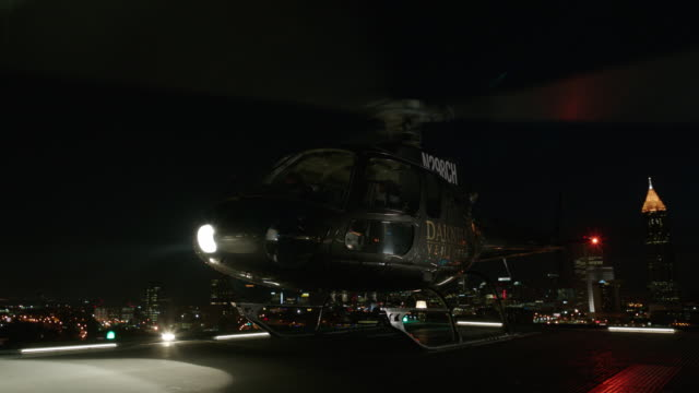 black aerospatiale as350 b2 ecurevil helicopter t/o & landing from hi-rise helipad on chicago office bldg. - night; 2 - takes: darnell ventures logo on side of fuselage - helicopter stock videos & royalty-free footage