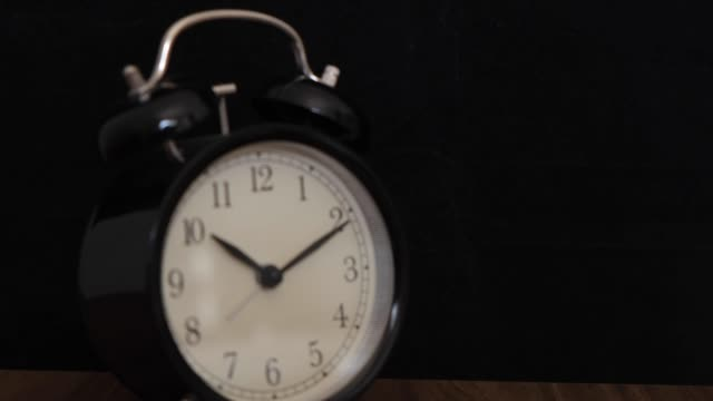 black alarm clock on a black background - number 2 stock videos & royalty-free footage