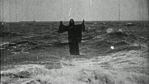 black and white 1914 composite wide shot jesus rising from water and walking on surface / praying as waves crash - christianity stock videos & royalty-free footage