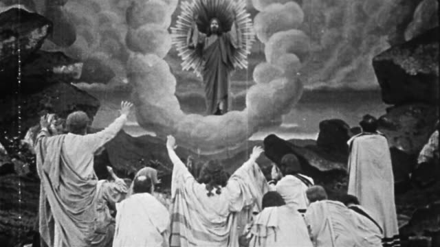 black and white 1914 composite wide shot jesus standing before crowd and halo appearing / ascending into heaven on cloud - heaven stock videos & royalty-free footage