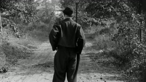 black and white 1917 medium shot larry semon walking and turning his empty pockets inside out in - pocket stock videos & royalty-free footage