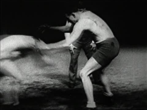 stockvideo's en b-roll-footage met black and white 1920s medium shot wrestling match between ed lewis and gus sonnenberg / one man takes down other / audio - 20 29 jaar