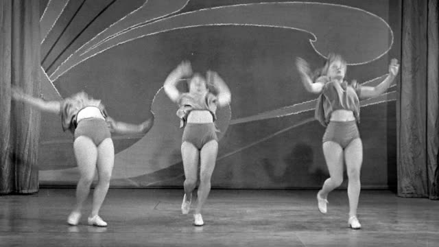 black and white 1930s medium shot three women performing synchronized flips over and over - akrobat stock-videos und b-roll-filmmaterial