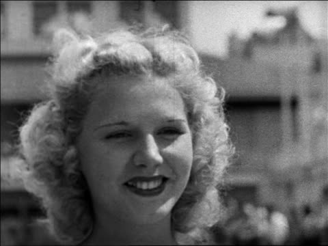 Black and white 1940 close up blonde woman smiling at camera / looks away / Coney Island, NY / industrial /AUDIO