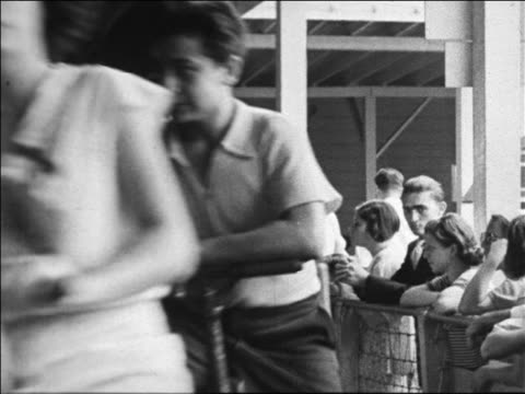 black and white 1940 close up people riding bicycle carousel past camera / coney island, ny / industrial /audio - around the fair n.y stock videos & royalty-free footage