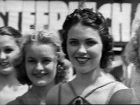 Black and white 1940 close up slight pan line of smiling women / Coney Island, NY / industrial /AUDIO