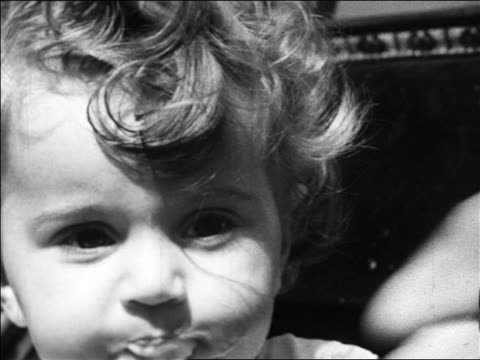 black and white 1940 close up small child eating ice cream cone (cone not visible) / coney island, ny / industrial - 1940 stock videos and b-roll footage