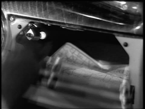 black and white 1940 close up woman's gloved hand opens car glove compartment and takes out map / industrial /audio - collector's car stock videos and b-roll footage