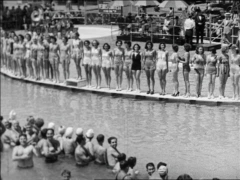 black and white 1940 high angle pan line of women in swimsuit contest standing on walkway over water / coney island, ny - beauty pageant stock videos and b-roll footage