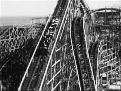 Black and white 1940 high angle tilt up roller coaster going to top of hill at Coney Island, NY / industrial /AUDIO