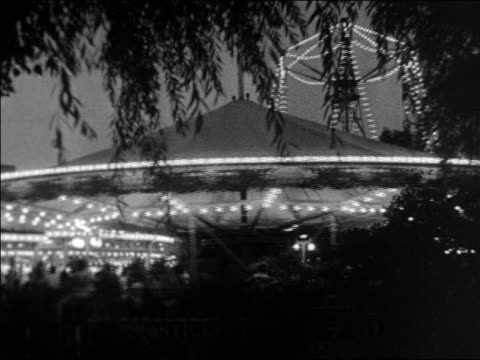 black and white 1940 lit carousel spinning at night / coney island, ny / industrial /audio - around the fair n.y stock videos & royalty-free footage