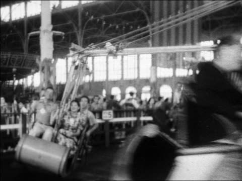 black and white 1940 people on amusement park ride passing camera / coney island, ny / industrial /audio - 1940 video stock e b–roll
