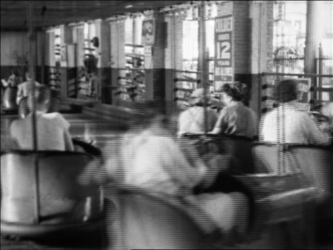 Black and white 1940 people riding bumper cars at Coney Island, NY / industrial /AUDIO