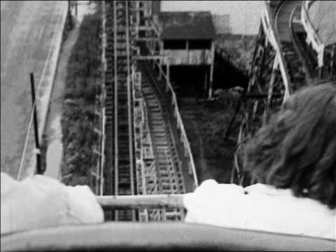 black and white 1940 roller coaster point of view speeding down hill / people visible in foreground / coney island, ny /audio - black and white stock videos & royalty-free footage