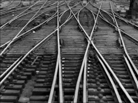 black and white 1942 train point of view on tracks in train yard / industrial /audio - shunting yard stock videos and b-roll footage