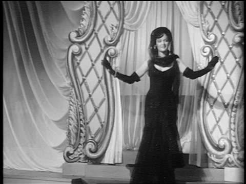 black and white 1943 dolly shot from big band to powers models modeling evening dresses / feature /audio - haute couture stock videos and b-roll footage