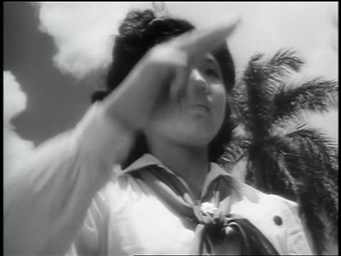 black and white 1943 low angle close up japanese-american girl scout saluting outdoors / palm trees in background / documentary audio - saluting stock videos & royalty-free footage