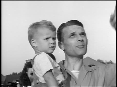 black and white 1944 close up man holding small boy / they talk and point up / documentary - 1944 stock videos and b-roll footage