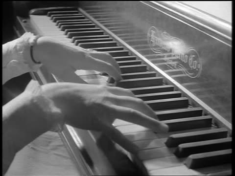 vidéos et rushes de black and white 1944 close up woman's hands playing piano / documentary - piano