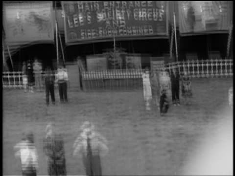 Black and white 1944 ferris wheel point of view at fair / documentary