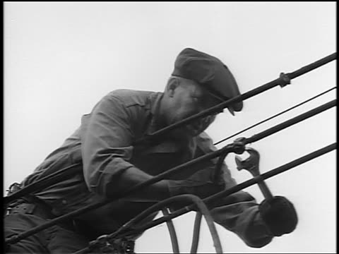 black and white 1944 low angle man using wrench on telephone line / documentary - wrench stock videos & royalty-free footage
