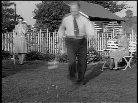 black and white 1944 middle aged man hitting ball in croquet game with other middle aged and senior people / docu. - 1944 stock videos and b-roll footage