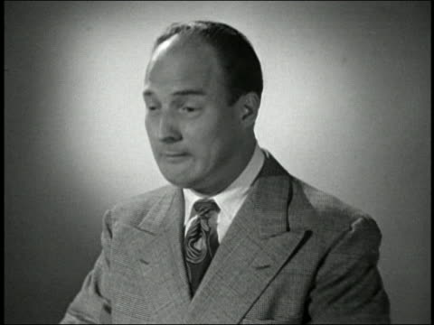 black and white 1945 close up man sneezing four times in a row / audio - sneezing stock videos & royalty-free footage