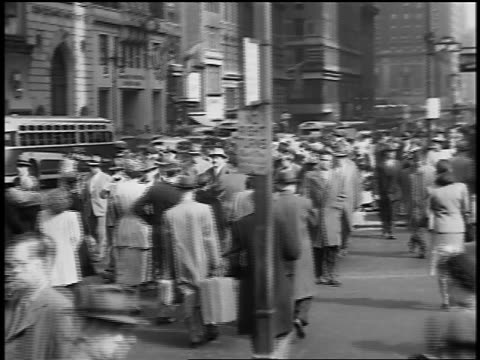 black and white 1945 high angle crowd crossing busy street at intersection / nyc / documentary - 1945 stock videos and b-roll footage
