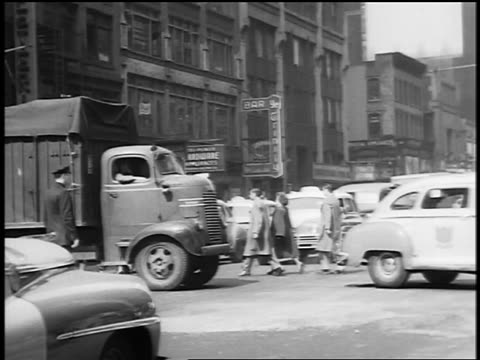 black and white 1945 traffic and pedestrians at intersection of busy city street / nyc / documentary - 1945 stock videos and b-roll footage