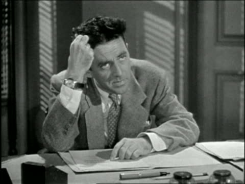black and white 1947 close up man sits at desk and twirls his hair / pulls hair out + looks surprised / audio - pulling stock videos & royalty-free footage