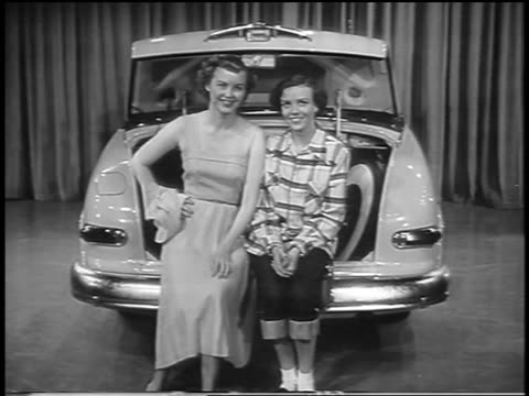 black and white 1949 2 women posing in trunk of mercury car in showroom / lean back to reveal 2 more women - collector's car stock videos & royalty-free footage