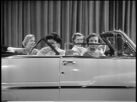 black and white 1949 4 women sitting in mercury convertible in showroom as power windows go up / indust. - 1949 stock-videos und b-roll-filmmaterial