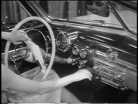 black and white 1949 woman operating controls on dashboard of new mercury car / industrial - 1949 bildbanksvideor och videomaterial från bakom kulisserna