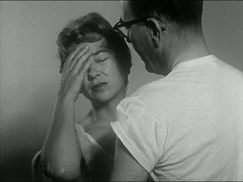 black and white 1963 medium shot wife rebuffing husband's advance / holding head / audio - headache stock videos & royalty-free footage