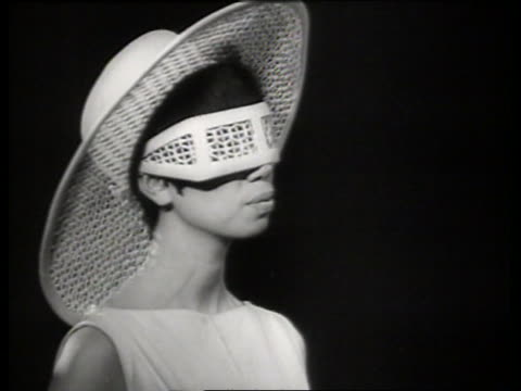 Black and white 1965 close up of fashion models modeling funky sunglasses / AUDIO