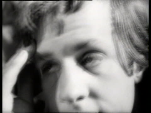 black and white 1965 close up of man wiping forehead / audio - young men stock videos & royalty-free footage
