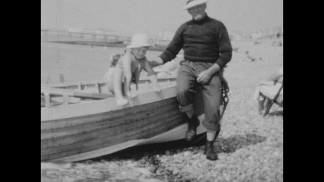 black and white archival home movie footage of a family on holiday in brighton uk circa 1930s - swimwear stock videos & royalty-free footage