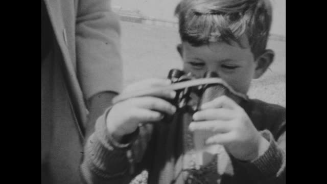 black and white archival home movie footage of a family on holiday in brighton uk circa 1930s - binoculars stock videos & royalty-free footage