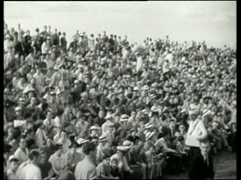 Black and white audience in bleachers at air show / NO
