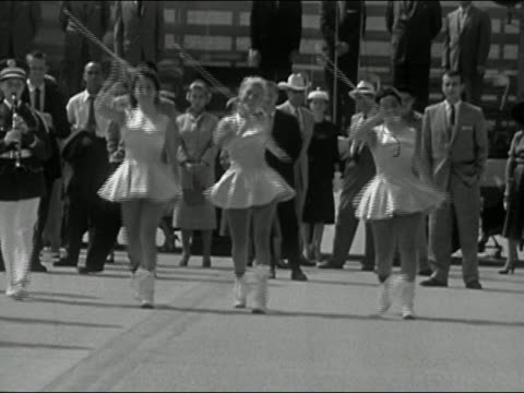 1956 black and white baton twirlers marching toward cam in street parade - marching band stock videos and b-roll footage