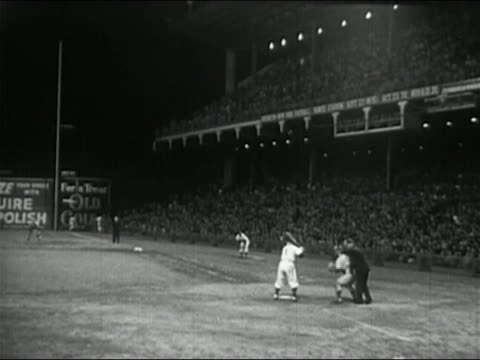 1950 black and white batter being thrown pitch during night game at Ebbets Field / Brooklyn New York City