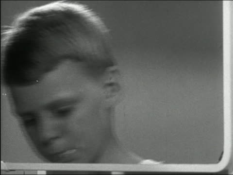 1949 black and white boy brushing teeth and taking drink of water - brushing teeth stock videos & royalty-free footage