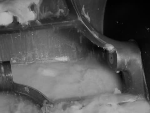1942 black and white close up bread dough being mixed in mechanical mixer / Camp Lee Virginia